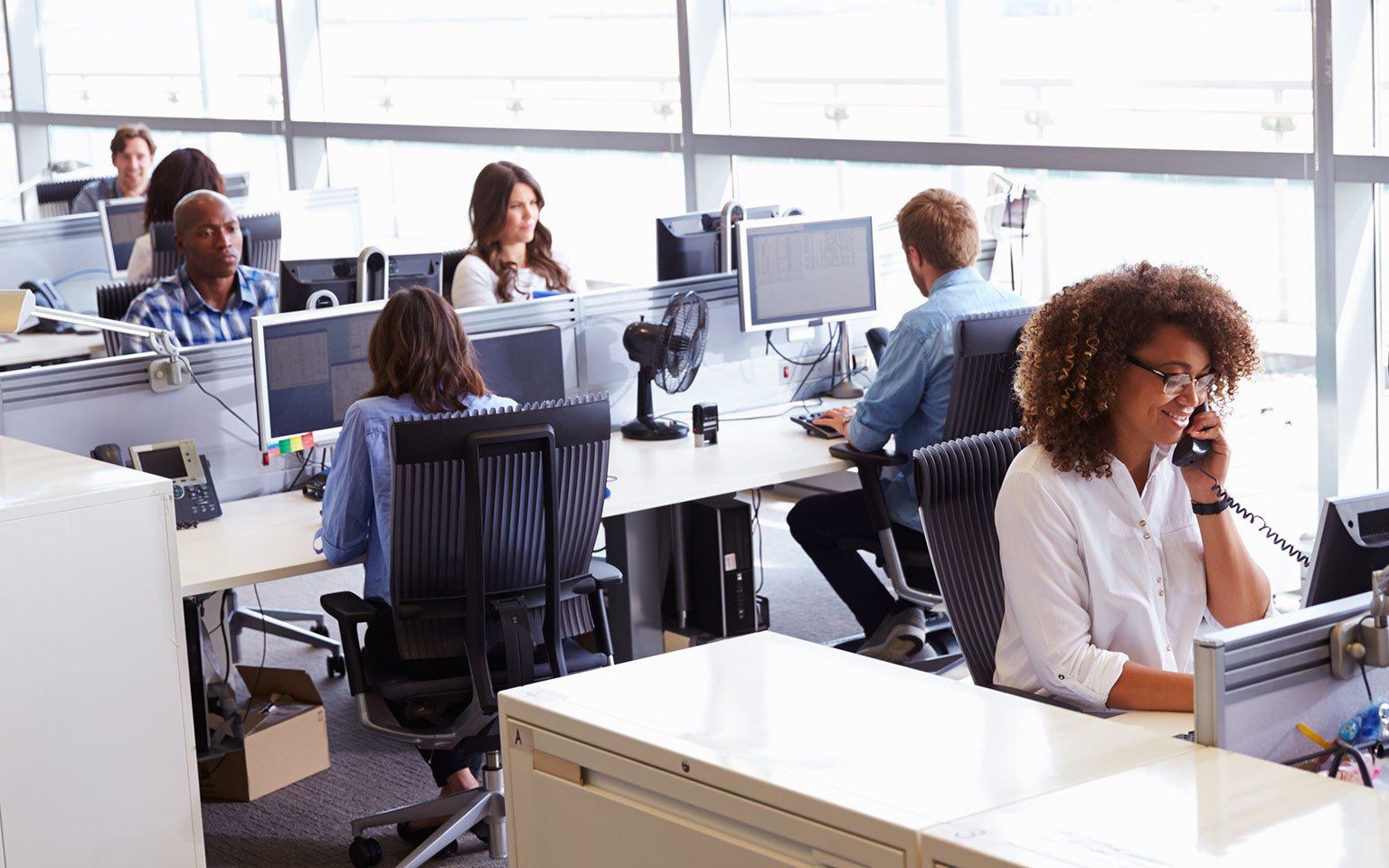 people at work in  a office